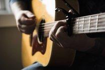 Cropped image of Man playing guitar — Stock Photo
