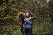 Mother and daughter hugging in wooded area, Lakefield, Ontario, Canada — Stock Photo