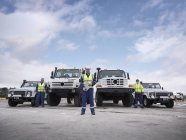 Emergency Response Team workers with specialist trucks — Stock Photo