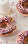 Decorated donuts and milk — Stock Photo