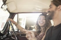 Young couple on road trip driving vintage car, Cape Town, South Africa — Stock Photo