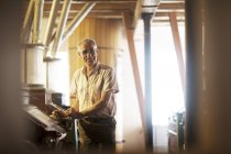 Portrait of male miller operating machine at wheat mill — Stock Photo