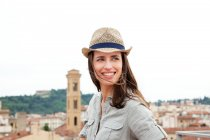 Young woman wearing straw hat, Florence, Tuscany, Italy — Stock Photo