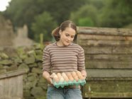 Girl With A Tray Of Eggs — Stock Photo