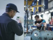 Worker adjusting thermostat in factory, motion blur — Stock Photo