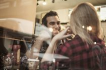 Young couple chatting in cafe — Stock Photo
