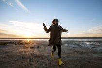 Woman enjoying beach at sunset — Stock Photo
