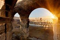 Ancient ruins of arena at sunset, croatia — Stock Photo