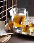 Glasses and jug of mulled cider on table — Stock Photo