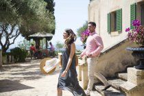 Couple on stairway at boutique hotel, Majorca, Spain — Stock Photo