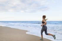 Young female runner  running on beach, Dominican Republic, The Caribbean — Stock Photo