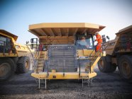 Dumper truck drivers in discussion in opencast coalmine — Stock Photo