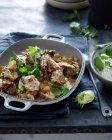 Dish of roasted meat with herbs and lime — Stock Photo