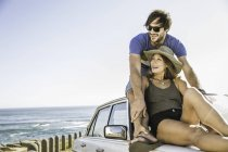 Mid adult couple looking out from top of car on coast road, Cape Town, South Africa — Stock Photo