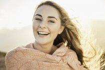 Woman enjoying breeze on sunny day — Stock Photo