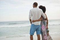 Couple looking out to sea from beach, Rio De Janeiro, Brazil — Stock Photo