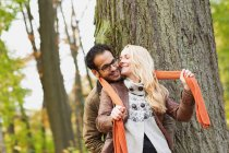 Smiling couple hugging in forest — Stock Photo