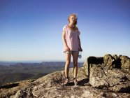 Hiker standing on top of rocky mountain — Stock Photo