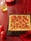 Square pizza with tomatoes and herbs — Stock Photo
