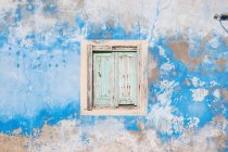 Dilapidated window, shutters and wall — Stock Photo