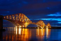 Modern bridge lit up at night — Stock Photo