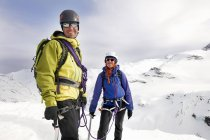 Mountaineers on snow-covered mountain looking at camera smiling, Saas Fee, Switzerland — Stock Photo