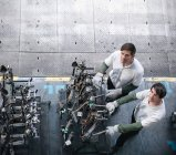 High angle portrait of engineers inspecting press parts in car factory — Stock Photo