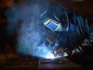 Welder using oxyacetylene torch in factory — Stock Photo