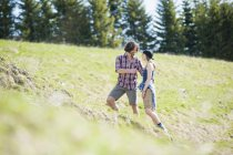 Mid adult couple walking in Tegernsee, Bavaria, Germany — Stock Photo