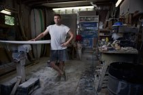 Portrait of mature man in surfboard workshop — Stock Photo