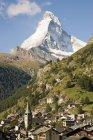 Distant view of Swiss town near matterhorn — Stock Photo