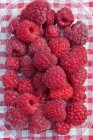 Ripe delicious Raspberries in punnet — Stock Photo