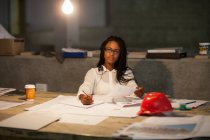 Female architect working late on site — Stock Photo