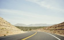 Empty Pierce Ferry Road in sunlight, Arizona, USA — Stock Photo