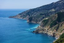 Aerial view of winding cliff road and sea, Big Sur, California, USA — Stock Photo