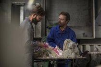 Sculptors in artist studio creating plaster cast sculpture — Stock Photo
