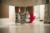 Feet of couple wearing socks in changing room — Stock Photo