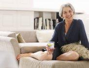 Senior woman in relaxing in robe, portrait — Stock Photo
