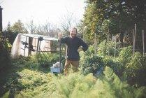 Young man in garden, portrait — Stock Photo