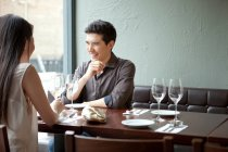 Young couple laughing in restaurant — Stock Photo