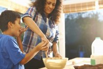Mother and son baking in kitchen at home — Stock Photo