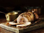 Carved chicken roast on kitchen table — Stock Photo