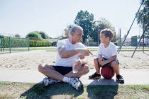 Man giving grandson basketball pep talk — Stock Photo