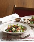 Bowl of poached salmon, orzo with cherry tomatoes and arugula — Stock Photo