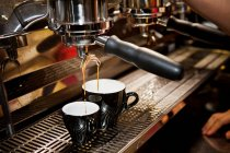 Cropped image of barista making latte in cafe — Stock Photo