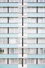 Blue colored high rise residential building facade — Stock Photo