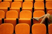 Female legs in a lecture theatre — Stock Photo