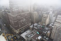 High angled cityscape in mist, New York City, USA — Stock Photo