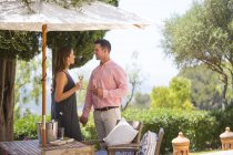 Couple with champagne on boutique hotel patio, Majorca, Spain — Stock Photo