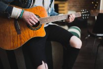Young man at home, playing guitar, mid section — Stock Photo